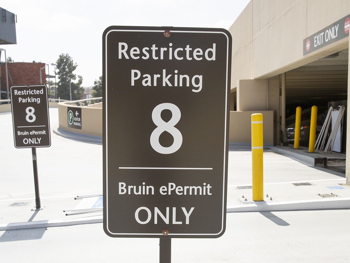 Restricted Parking sign on UCLA campus for a virtual permit-only parking facility